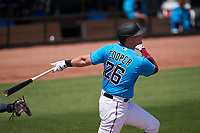 Miami Marlins Garrett Cooper (26) bats during a Major League Spring Training game against the Houston Astros on March 21, 2021 at Roger Dean Stadium in Jupiter, Florida.  (Mike Janes/Four Seam Images)