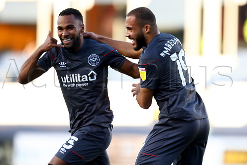 31st October 2020; Kenilworth Road, Luton, Bedfordshire, England; English Football League Championship Football, Luton Town versus Brentford; Rico Henry of Brentford celebrates his goal with Bryan Mbeumo for 0-1 in the 20th minute