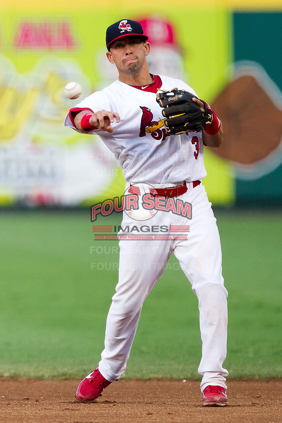 Jose Garcia (3) of the Springfield Cardinals throws to first during a game against the Northwest Arkansas Naturals at Hammons Field on July 31, 2011 in Springfield, Missouri. Northwest Arkansas defeated Springfield 9-1. (David Welker / Four Seam Images)