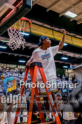 16 March 2019: University of Vermont Catamount Guard Stef Smith, a Sophomore from Ajax, Ontario, cuts himself a piece of net after a victory over the UMBC Retrievers in the America East Championship Game at Patrick Gymnasium in Burlington, Vermont. The Catamounts defeated the Retrievers 66-49, avenging their loss against the same team in last years' Championship Game. Mandatory Credit: Ed Wolfstein Photo *** RAW (NEF) Image File Available ***