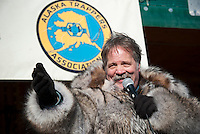 Auctioneer Steve Childs with the Alaska Trappers Association takes bids during the Rondy fur auction in downtown Anchorage.