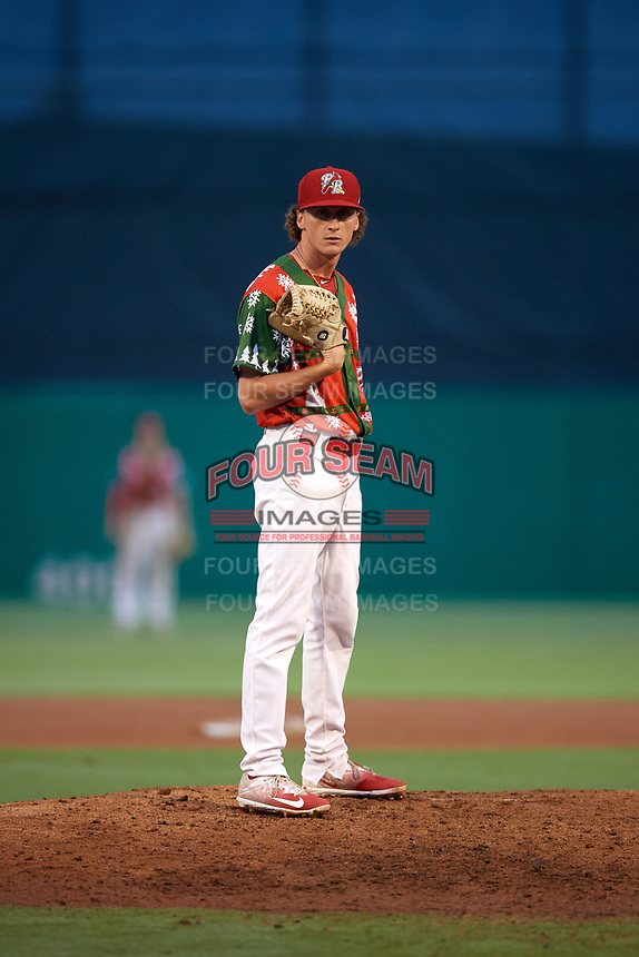 "Palm Beach Cardinals relief pitcher Brady Bowen (29) looks in for the sign during a game against the Charlotte Stone Crabs on July 22, 2017 at Roger Dean Stadium in Palm Beach, Florida.  The Cardinals wore special ""Ugly Sweater"" jerseys for Christmas in July.  Charlotte defeated Palm Beach 5-2.  (Mike Janes/Four Seam Images)"