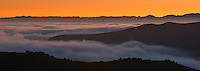 Rolling clouds over farmland on Banks Peninsula at sunset, Canterbury, South Island, New Zealand
