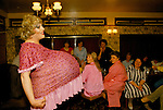 'HEN PARTY', DRAG ARTIST FROM THE HARLEQUEENS, DRESSED AS A PREGNANT WOMAN WITH LARGE BUMP, PERFORMING AT THE DUKE OF CAMBRIDGE PUB IN SOUTH LONDON<br />