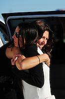 Sept. 23, 2011; Ennis, TX, USA: NHRA funny car driver Alexis DeJoria (left) gets a hug from Melanie Troxel during qualifying for the Fall Nationals at the Texas Motorplex. Mandatory Credit: Mark J. Rebilas-