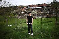 BULGARIA, Lazhnitsa, April 17, 2011. A young Bulgarian muslim man poses for a portrait in his backyard in the remote village of Lazhnitsa in the Rhodope Mountains. southern Bulgaria. Bulgarian Muslims, which today are nearly 8% of the country's population and the largest muslim minority community in the European Union, revived their cultural and religious traditions after the fall of communist regime in Bulgaria in 1989. .BULGARIE, Lazhnitsa, 17 Avril 2011. Un jeune Bulgare de confession musulmane prends la pose dans l'arrière-cour de sa maison dans le petit village de Lazhnitsa dans les montagnes des Rhodopes en Bulgarie. La minorité musulmane qui représente aujourd'hui près de 8% de la population totale du pays et qui est la plus large majorité musulmane dans les pays de l'Union Européenne a ravive ses traditions culturelles et religieuse après la chute du régime communiste Bulgare en 1989.