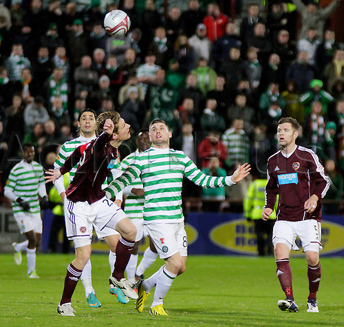 28.11.2012 Edinburgh, Scotland. Marius Zaliukas and Gary Hooper in action during the Scottish Premier League game between Heart of Midlothian and Celtic from Tynecastle Stadium.