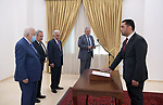 Judge Abdullah Abu Samhadana sworn in as a judge in the Constitutional Court in front of Palestinian President Mahmoud Abbas, in the West Bank city of Ramallah on June 12, 2021. Photo by Thaer Ganaim