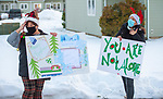 WATERTOWN, CT-122120JS05- Watertown residents  Roberta Hardt, left, and Lindsey Shaker, right, spread a little Christmas cheer to residents at Watertown Housing Authority properties on Monday. <br /> Jim Shannon Republican-American