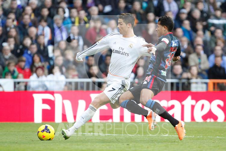 Real Madrid´s Cristiano Ronaldo (L) and Granada´s Murillo during La Liga 2013-14 match in Santiago Bernabeu stadium in Madrid, Spain. January 25, 2014. (ALTERPHOTOS/Victor Blanco)