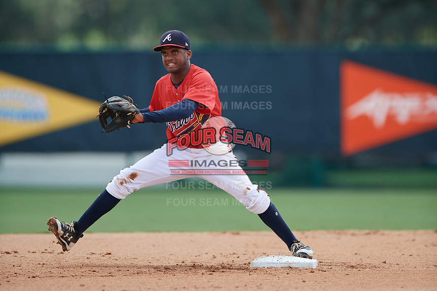 GCL Braves second baseman Luis Ovando (9) stretches to receive a throw during a game against the GCL Pirates on July 27, 2017 at ESPN Wide World of Sports Complex in Kissimmee, Florida.  GCL Braves defeated the GCL Pirates 8-6.  (Mike Janes/Four Seam Images)