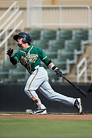 Luis Pintor (8) of the Greensboro Grasshoppers follows through on his swing against the Kannapolis Intimidators at Kannapolis Intimidators Stadium on August 13, 2017 in Kannapolis, North Carolina.  The Grasshoppers defeated the Intimidators 4-1 in 10 innings in the completion of a game suspended on August 12, 2017.  (Brian Westerholt/Four Seam Images)