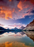 Sunrise clouds over Bow Lake with reflection. Banff National Park, Alberta, Canada
