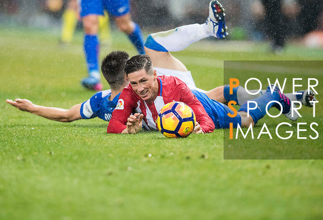Fernando Torres of Atletico de Madrid and Alberto Martin (l) of Deportivo Leganes fall as they compete for the ball with during their La Liga match between Atletico de Madrid and Deportivo Leganes at the Vicente Calderón Stadium on 04 February 2017 in Madrid, Spain. Photo by Diego Gonzalez Souto / Power Sport Images