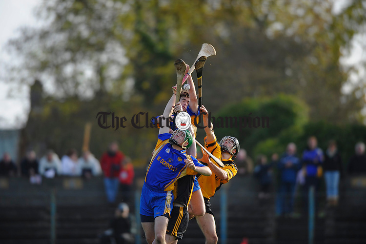 Newmarkets Colin Ryan and Enda Kelly contest a high ball with Clonlara's Fenan Nihill during their senior county final at Cusack Park. Photograph by John Kelly.