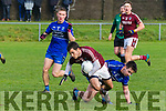 Dromid's Gearoid J.Ó Suilleabháin gets the advantage for this challenge from Renards Cian O'Leary but gets to his feet and continues his attack.