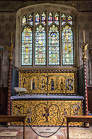 UK, England, Ewelme.  St. Mary the Virgin Church, 15th Century.  Altar of St. John the Baptist with Medieval Glass Fragments in Window behind.