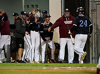 Riverview Rams Cole Griffith (24) is greeted at the dugout by teammates after scoring a run during a game against the Sarasota Sailors on February 19, 2021 at Rams Baseball Complex in Sarasota, Florida. (Mike Janes/Four Seam Images)