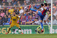 Pictured: Lukasz Fabianski of Swansea (L) prepares to catch a shot by Joel Ward of Crystal Palace (R)<br /> Re: Premier League match between Crystal Palace and Swansea City at Selhurst Park on Sunday 24 May 2015 in London, England, UK