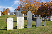 Row of headstones at Old Cemetery on Millen Pond Road in Washington, New Hampshire USA during the autumn months.