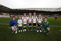 ATTENTION SPORTS PICTURE DESK<br /> Pictured: Swansea City mascots with a cardiff City mascot <br /> Re: Coca Cola Championship, Swansea City Football Club v Cardiff City FC at the Liberty Stadium, Swansea, south Wales. Saturday 07 November 2009