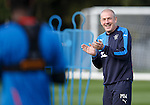 Mark Warburton applauding the efforts of his players at training today