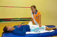 2013-08-17, Netherlands, Raalte,  TV Ramele, Tennis, NRTK 2013, National Ranking Tennis Champ,  Olga Kalyuzhnaya receives a fysio treatment prior to her final match<br /> <br /> Photo: Henk Koster