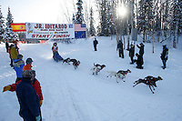 Sunday February 27, 2010   Meredith Mapes leaves the start line of the Junior Iditarod at Willow Lake , Alaska