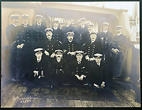 BNPS.co.uk (01202 558833)<br /> Pic: HAldridge/BNPS<br /> <br /> The crew of the Minia.<br />  <br /> A poignant cross made from drift wood from the Titanic by a seaman tasked with recovering the bodies from the disaster as surfaced 107 years later.<br /> <br /> The small religious symbol was delicately hand carved by Samuel Smith, a joiner on the cable-laying ship Minia which was tasked with searching for bodies.<br /> <br /> Mr Smith was so moved by the macabre experience that he honoured the victims by creating the wooden cross on a three-tiered plinth.<br /> <br /> He made it from a piece of oak wood he plucked from the ocean that has come from the sunken liner.<br /> <br /> The archive is estimated to sell for £35,000 at H Aldridge in Devizes.