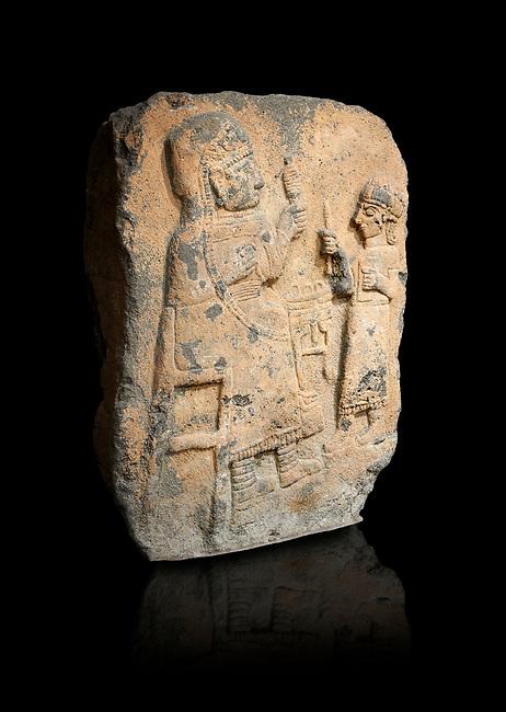 Hittite monumental relief sculpture. Late Hittite Period - 900-700 BC. Adana Archaeology Museum, Turkey. Against a black background