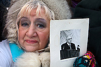 Moscow, Russia, 04/02/2012..A woman holds a photograph of Nobel winning physicist and Soviet dissident Andrei Sakharov as tens of thousands of demonstrators march in central Moscow and protest against election fraud and Prime Minister Vladimir Putin in temperatures of -20 centigrade. Organisers claimed an attendance of 130,000 despite the bitter cold.