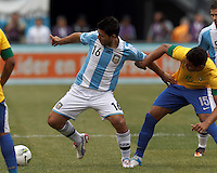 Argentina substitute forward  Sergio Aguero (16) attempts to control the ball as Brazil substitute midfielder Casemiro (15) defends. In an international friendly (Clash of Titans), Argentina defeated Brazil, 4-3, at MetLife Stadium on June 9, 2012.