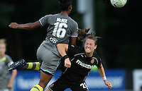 Philadelphia defender, Kia McNeill (16) and Western New York forward, Brittany Bock (21) collide in midfield.  Philadelphia stayed on top of the table with a 2-1 victory over the Western New York Flash on July 9th at Widener University in Chester, PA.