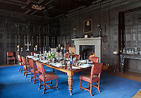 The panelled Elizabethan dining room. A portrait of Nicholas Prideaux hangs above the fireplace. The woodwork is largely restored timber integrated with some of the remaining 16th century pieces that survived a fire in the 19th century