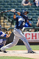 New Orleans Zephyrs shortstop Juan Diaz #29 follows through on his swing during the Pacific Coast League baseball game against the Round Rock Express on May 4, 2014 at the Dell Diamond in Round Rock, Texas. The Express defeated the Zephyrs 15-12. (Andrew Woolley/Four Seam Images)