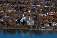 aerial photograph of Sainte-Famille Church Boucherville, Montérégie, Quebec, Canada at the Saint Lawrence River in fall | photographie aérienne de l'église Sainte-Famille de Boucherville, Montérégie, Québec, Canada au fleuve Saint-Laurent à l'automne