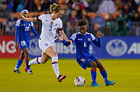 HOUSTON, TX - JANUARY 28: Samantha Mewis #3 of the United States battles Melchie Dumonay #6 of Haiti for a ball during a game between Haiti and USWNT at BBVA Stadium on January 28, 2020 in Houston, Texas.