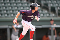 Canter fielder Cole Brannen (10) of the Greenville Drive runs out a batted ball in a game against the Delmarva Shorebirds on Friday, August 2, 2019, in the continuation of rain-shortened game begun August 1, at Fluor Field at the West End in Greenville, South Carolina. Delmarva won, 8-5. (Tom Priddy/Four Seam Images)