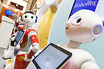 SoftBank's humanoid robots Pepper dressed with uniforms on display during a media event at Pepper World 2016 exhibition on July 20, 2016, Tokyo, Japan. Kenichi Yoshida, vice president of business development for SoftBank Robotics along with other guests spoke about the new features of Pepper such as Chinese response and speech recognition, and duty free tax refunds and electronic payments services, in response to business needs. Pepper for Biz 2.0 press conference was held a day before the start of Pepper World 2016 exhibition, where developers will introduce applications for SoftBank's robot Pepper. Pepper World will run until July 22. (Photo by Rodrigo Reyes Marin/AFLO)