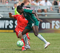 St. Louis Athletica defender Tina Ellertson (8) and Washington Freedom forward Abby Wambach (20) collide during a WPS match at Anheuser-Busch Soccer Park, in Fenton, MO, June 20 2009. Wambach left the game shortly afterward as Washington  won the match 1-0.