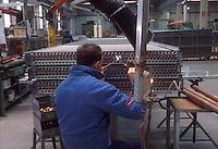 - Alfa-Laval factory, production of heat exchangers....- stabilimento Alfa-Laval, produzione di scambiatori di calore