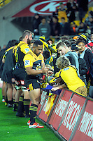 Ngani Laumape signs autographs after the Super Rugby match between the Hurricanes and Reds at Westpac Stadium, Wellington, New Zealand on Saturday, 14 May 2016. Photo: Dave Lintott / lintottphoto.co.nz