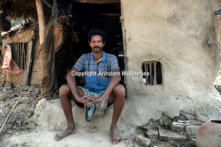 Bimal Halder, 43, is a victim of a tiger attack, who fought the tiger empty-handedly and could escape a certain death. He was in the local hospital for one year before he got partially cured with deep scars on the face and head. Since then he never went to the forest and now works as a ricksahw puller in his locality. Sunderban, West Bangal, India. Arindam Mukherjee