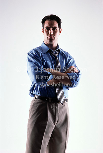 Caucasian looking man wearing a blue shirt and tie facing forward