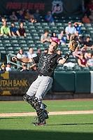 Dustin Garneau (13) of the Albuquerque Isotopes on defense against the Salt Lake Bees in Pacific Coast League action at Smith's Ballpark on June 8, 2015 in Salt Lake City, Utah.  (Stephen Smith/Four Seam Images)
