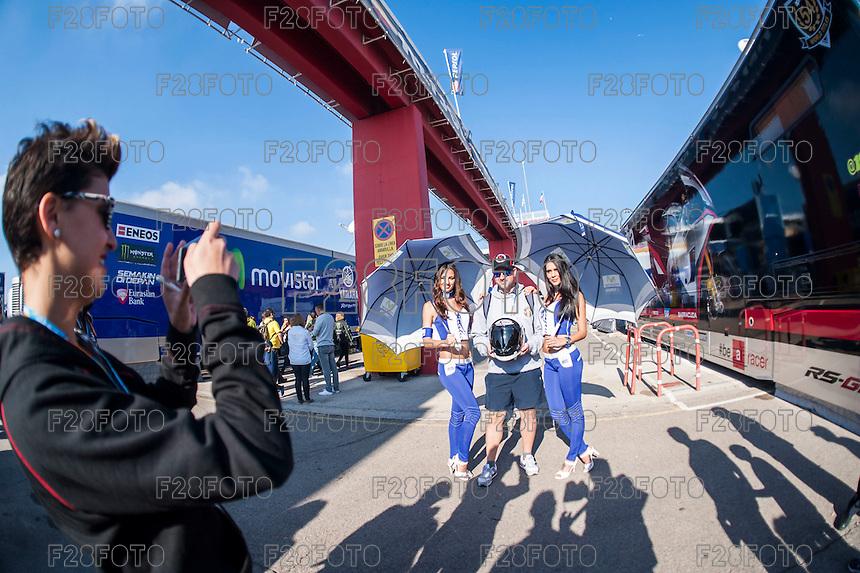 VALENCIA, SPAIN - NOVEMBER 8: Fans shoot a photo with yamaha paddok girls during Valencia MotoGP 2015 at Ricardo Tormo Circuit on November 8, 2015 in Valencia, Spain