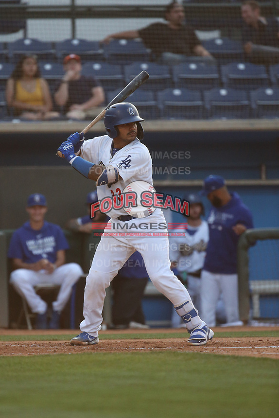 Wladimir Chalo (33) of the Rancho Cucamonga Quakes bats against the Visalia Rawhide at LoanMart Field on June 17, 2021 in Rancho Cucamonga, California. (Larry Goren/Four Seam Images)