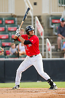Nick Basto (27) of the Kannapolis Intimidators at bat against the Greensboro Grasshoppers at CMC-Northeast Stadium on July 13, 2013 in Kannapolis, North Carolina.  The Intimidators defeated the Grasshoppers 7-5.   (Brian Westerholt/Four Seam Images)