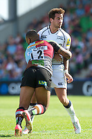 Danny Cipriani of Sale Sharks is tackled by Jordan Turner-Hall of Harlequins during the Aviva Premiership match between Harlequins and Sale Sharks at The Twickenham Stoop on Saturday 15th September 2012 (Photo by Rob Munro)