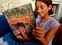 Teenager reading a Harry Potter book - Harry Potter and the Goblet of Fire. Anda Clark. Venice, California.